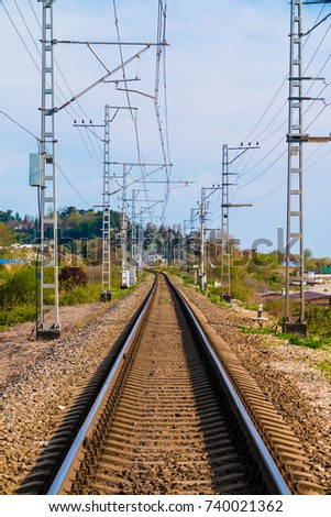 Vertical view of the railroad going into the distance in sunny day, Sochi, Russia #740021362
