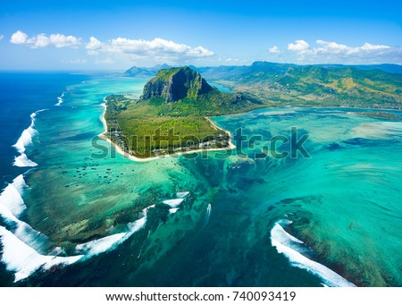 Aerial view of Mauritius island panorama and famous  Le Morne Brabant mountain, beautiful blue lagoon and underwater waterfall #740093419