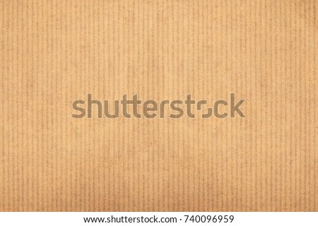 Kraft paper texture vertical striped pattern for wrapping. Kraft paper texture background. Royalty-Free Stock Photo #740096959