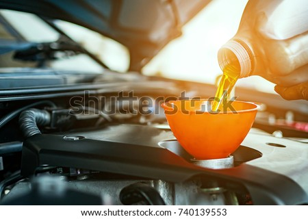 Hand mechanic in repairing car,Change the Oil #740139553