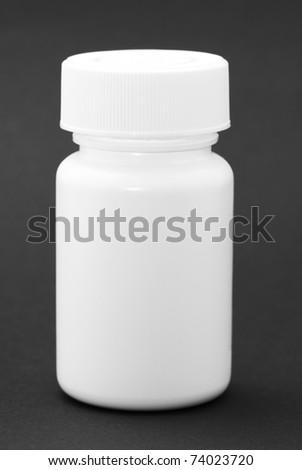 White medicine bottle on black background #74023720