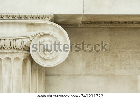 Decorative detail of an ancient Ionic column. close up. Royalty-Free Stock Photo #740291722