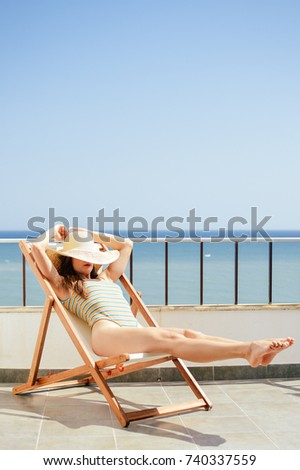 Attractive woman relaxing on holiday sunny outdoors background. Luxury vacation summertime #740337559