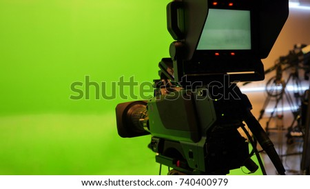 Television studio with camera. Camera on tripod #740400979