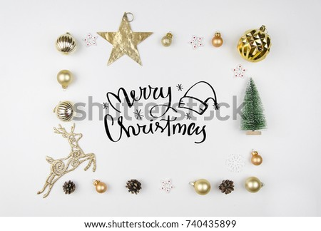 Christmas lettering. Frame made of christmas decoration, Christmas deer, balls, cones, golden star and fir tree. Flat lay, top view. Trendy greeting card modern calligraphy #740435899