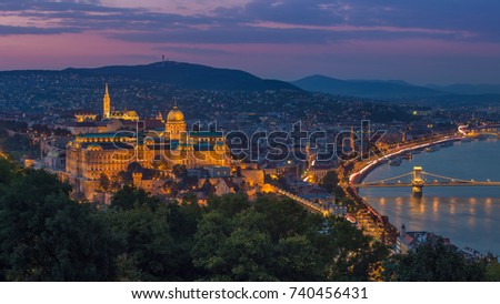 Budapest, Hungary - Colorful sunset at magic hour over Budapest with Buda Castle Royal Palace and famous Szechenyi Chain Bridge #740456431