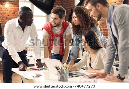 Group of five creative worker brainstorm together in office, new style of workspace, happy scene of people in office. #740477293