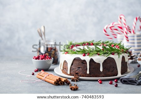 Christmas fruit cake, pudding on white plate. Copy space. #740483593