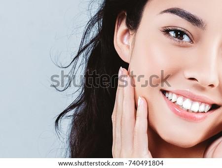 Beautiful woman skincare  beauty face closeup portrait #740491804
