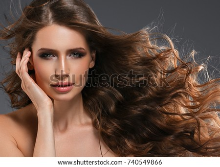 Beauty Woman long black hair. Beautiful Spa model Girl with Perfect Fresh Clean Skin. Brunette woman smiling over gray background. Beautiful hairstyle #740549866