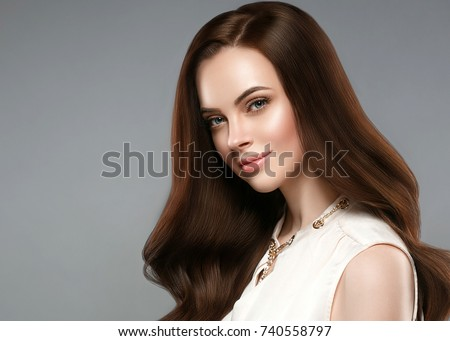 Beautiful shine hair woman. Brunette with long hair and healthy skin over gray background. #740558797
