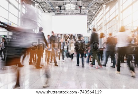 anonymous people at a trade fair  Royalty-Free Stock Photo #740564119