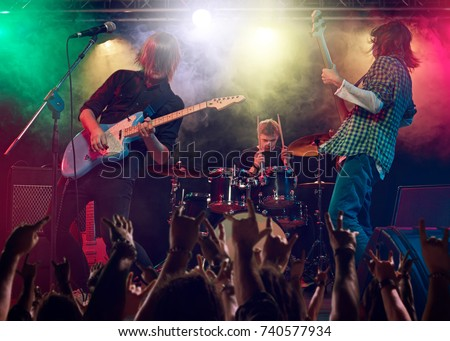 Rock show. Concert at the club. Royalty-Free Stock Photo #740577934