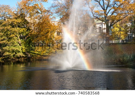 Latvia. The park in Riga. Magnificent fountain in the channel  with the shining rainbow. #740583568