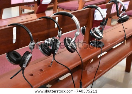 Headphones hang on chair in the Church.