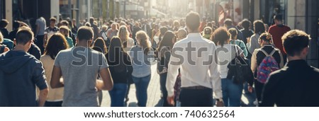 crowd of people in a shopping street #740632564