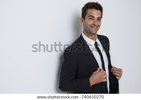 Smiling guy in business suit in white studio #740650270