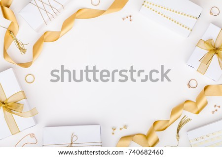 golden jewelry and gift boxes on white background with copy space for text. fashion and shopping concept. wedding, marriage or birthday composition. flat lay, top view #740682460