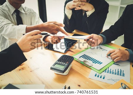 Co-workers are consultants on business documents, tax, transactions and business combinations after a bankrupt merger with a newly founded company. #740761531