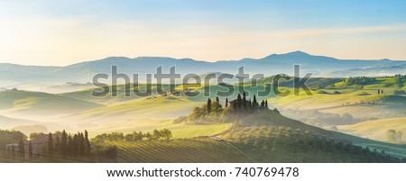 Beautiful foggy landscape in Tuscany, Italy #740769478