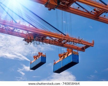 Industrial port crane lift up loading export containers box onboard at port of Thailand,The port crane type's twinlift is the best solution for port operations. #740858464