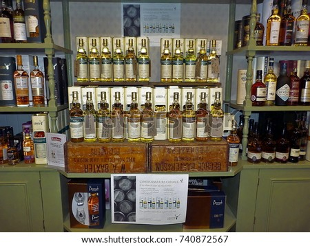 a variety of Scotch whiskeys on display  shelves Baxters Highland Village shop Tuesday 24 October 2017 at 14 pm Located in Scotland on the A96  Fochabers Postcode: IV32 7LD #740872567