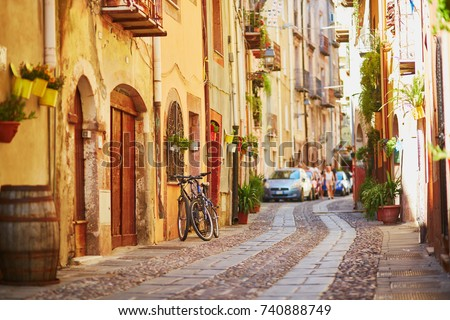 Typical colorful Italian houses on a street of Bosa, Sardinia, Italy #740888749