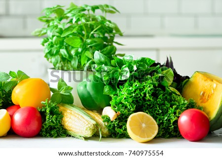Woman peeling pumpking, vegetables, onion, tomatoes, corn, bell pepper, spinach, lettuce leaves. Clean eating, detox concept #740975554