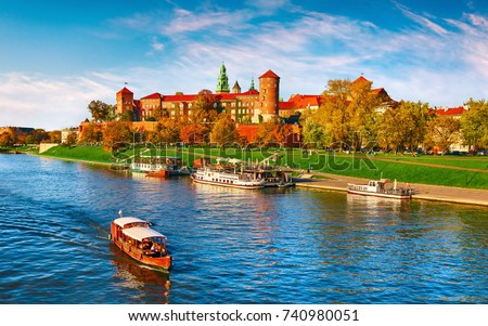 Wawel castle famous landmark in Krakow Poland. Picturesque landscape on coast river Wisla. Autumn sunset with white sky and cloud. #740980051