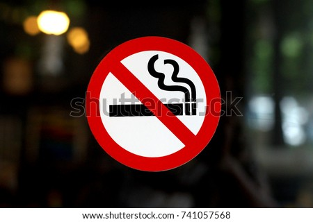 photo of no smoking sign on restaurant window