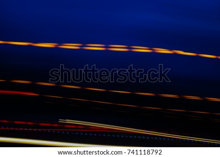 Abstract motion blur of multicolor night light on a black backgr #741118792