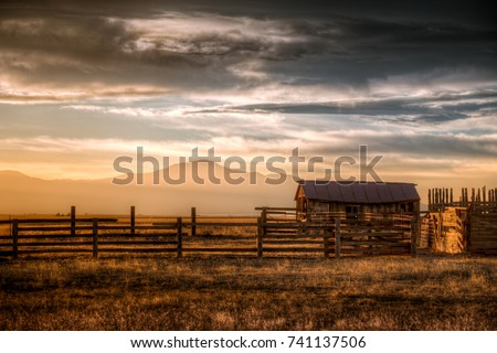 Old farm at sunset in Colorado. Royalty-Free Stock Photo #741137506