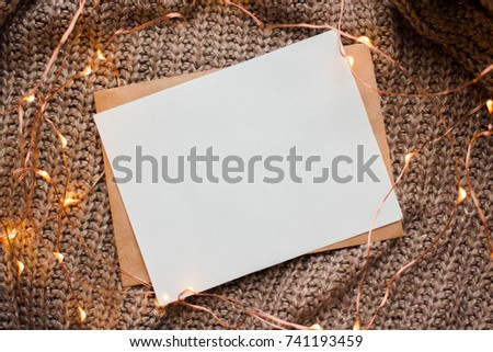 card mockup with brown knitted background with copy place with garland