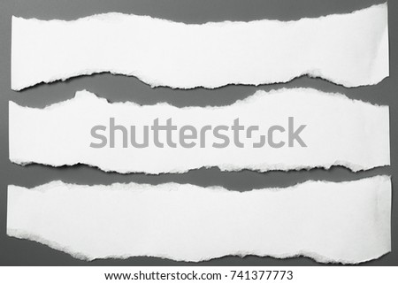 white torn paper on gray background. collection paper rip Royalty-Free Stock Photo #741377773