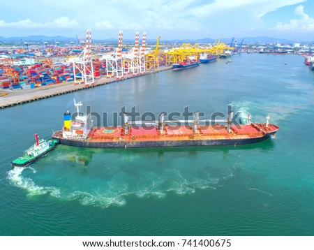 container,container ship in import export and business logistic,By crane,Trade Port , Shipping,cargo to harbor.Aerial view,Water transport,International,Shell Marine,transportation,logistic,trade,port #741400675