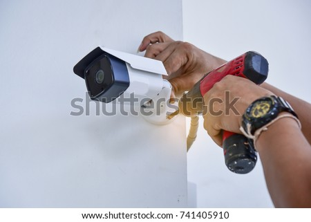 Technician installing CCTV camera for security Royalty-Free Stock Photo #741405910