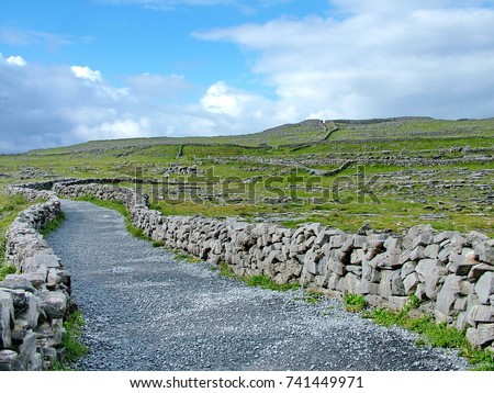 Gravel pathway to Dún Aonghasa the largest prehistoric stone fort on Inishmore in the Aran Islands, County Galway, Republic of Ireland.  #741449971