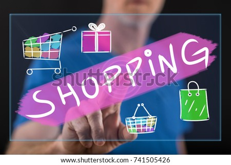 Man touching a shopping concept on a touch screen with his finger #741505426