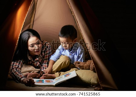 Mother reading book to her little son #741525865