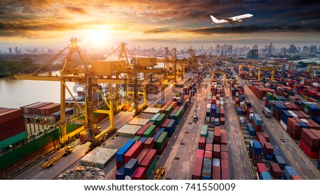 Logistics and transportation of Container Cargo ship and Cargo plane with working crane bridge in shipyard at sunrise, logistic import export and transport industry background #741550009