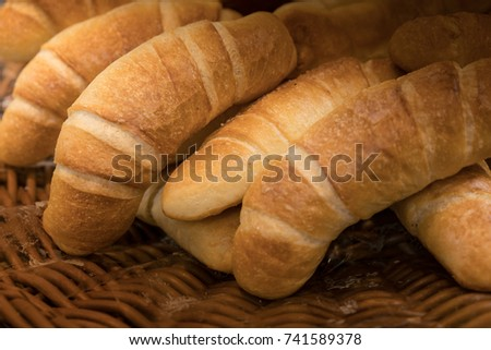 Bread is a staple food prepared from a dough of flour and water, usually by baking. #741589378