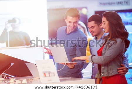 young people buying and testing latest laptop Royalty-Free Stock Photo #741606193