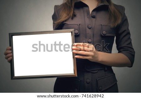 Grateful letter. Gratitude concept. Accolade. Thank letter. Special offer. Young business women in strict dress holding in hands empty blank photo frame. Appreciation document. #741628942