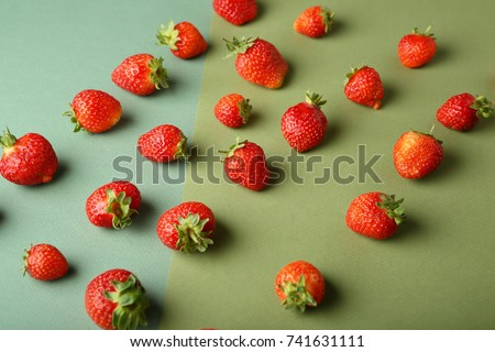 Organic strawberries on green background, food above #741631111