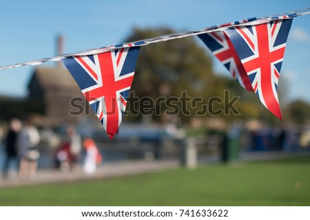 bright union jack flag triangle bunting with typical British background in Windsor