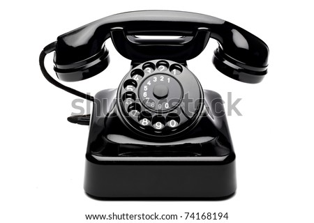 an old telephon with rotary dial Royalty-Free Stock Photo #74168194