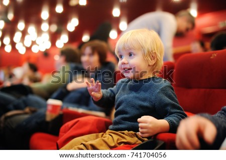 Cute toddler boy watching cartoon movie in the cinema. Leisure/entertainment for family with kids. Royalty-Free Stock Photo #741704056