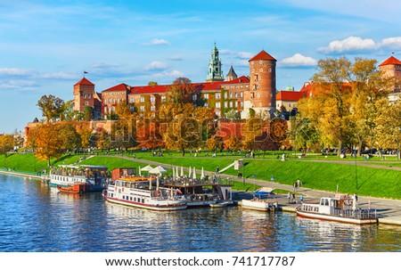 Wawel castle famous landmark in Krakow Poland. Picturesque landscape on coast river Wisla. Autumn sunset with white sky and cloud. #741717787