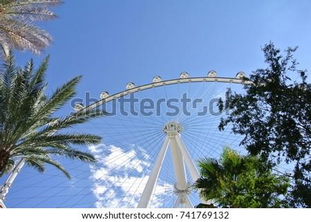 Upward view of a grand Ferris wheel #741769132