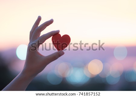 hand carrying red heart Royalty-Free Stock Photo #741857152